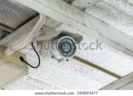 Small cctv with control box on the ceiling house. - stock photo