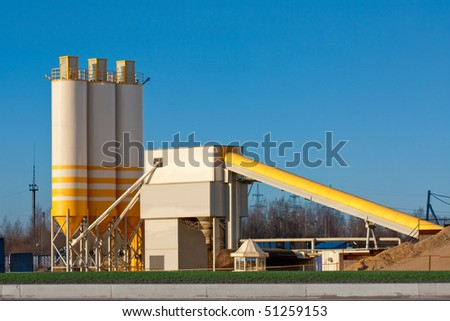 Small Cement Factory with three silos and conveyor - stock photo