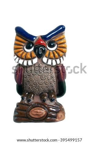 Small ceramic decorative owl isolated on white background - stock photo