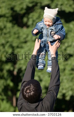 Small child flying - stock photo