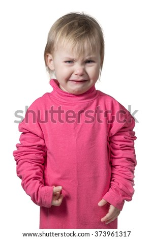 Small child in a crimson blouse large size bitterly crying isolated on white background - stock photo