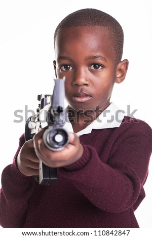 Small children with guns in school: Dangerous or scared? - stock photo
