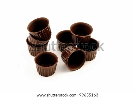 small Chocolate edible cups for pastry isolated on white background - stock photo