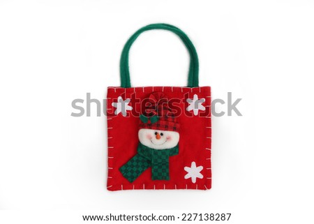 small christmas bag with decorative christmas snowman, isolated on white  - stock photo