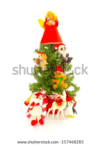Small christmas tree with festive decorations - stock photo