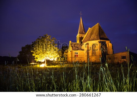 Small church by Night in Persingen, Gelderland, The Netherlands - stock photo