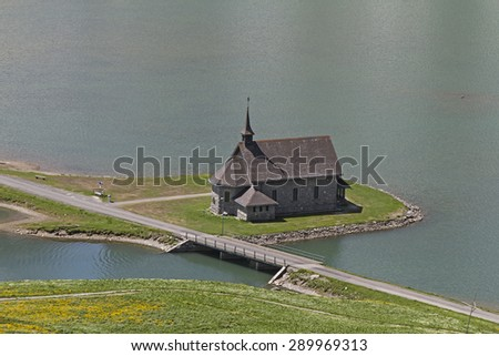 Small church in the small ski and summer resort Melchsee Frutt in Obwalden in Central Switzerland. - stock photo