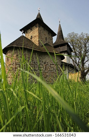 Small church made by stone and wood placed in the middle of the nature somewhere in Romania - stock photo