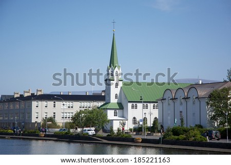 Small church near the pond in the center of Reykjavik on a sunny day, Iceland - stock photo