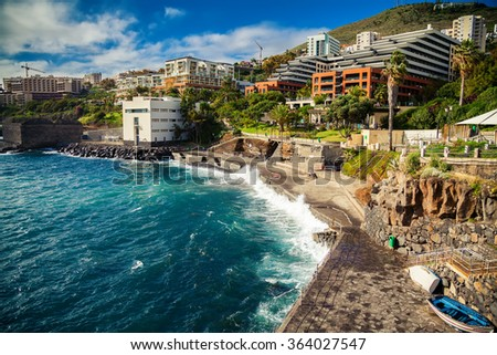 small city beach near bath complex Lido in Funchal, Madeira island - stock photo