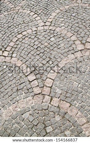 small cobblestone sidewalk made of cubic stones - tileable textu - stock photo