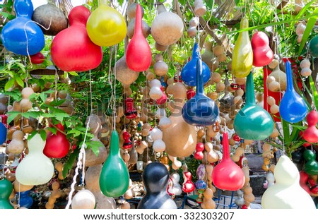 Small colorful hanging pumpkins - merry sunny background - stock photo