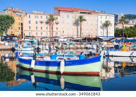 Small colorful wooden fishing boat moored in old port of Ajaccio, Corsica, France - stock photo