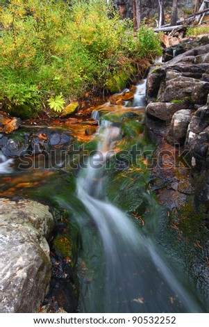 Small creek cascade in the Lewis and Clark National Forest of Montana. - stock photo