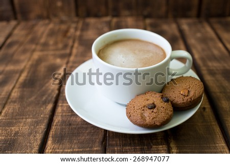 Small cup of black coffee on a brown background  - stock photo