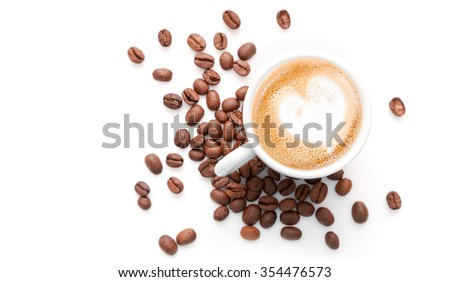Small cup of cappuccino with coffee beans and heart shaped milk foam, top view isolated on white background - stock photo