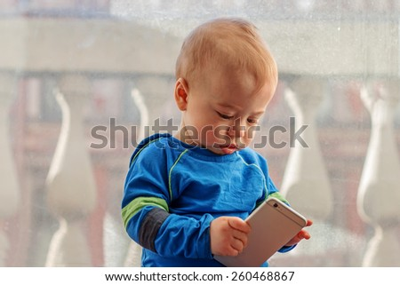 Small cute boy with mobile phone - stock photo
