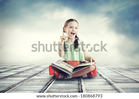 Small cute child reading a book - stock photo