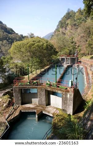 Small dam in mountain - stock photo