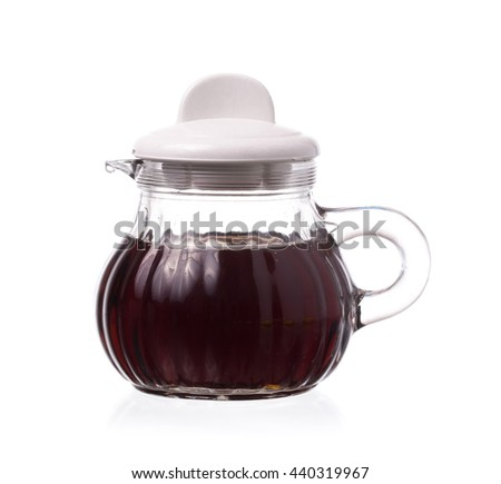 Small decanter with Soy sauce isolated on the white background - stock photo