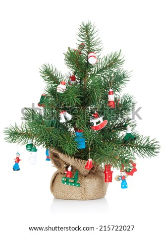 Small decorated christmas tree. Isolated on white background - stock photo