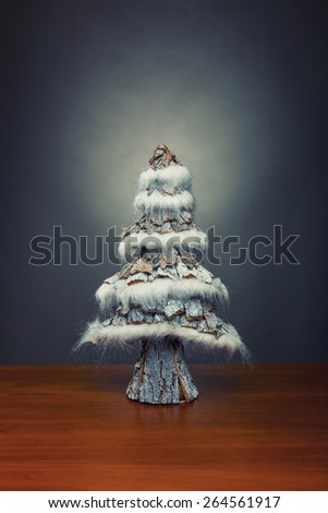 Small decorative christmas tree on wooden table - stock photo
