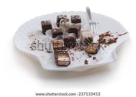 Small delicious cakes dusted with powdered sugar served on saucer - stock photo