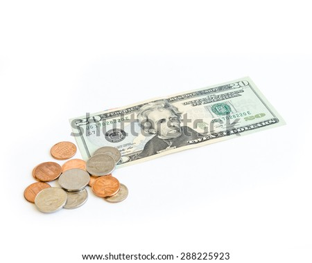 Small denomination US dollars banknote and coins on white background. Concept for tipping, cash reward concept. Currency, business and finance concept. - stock photo