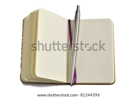 Small diary, notebook with metallic pen - stock photo