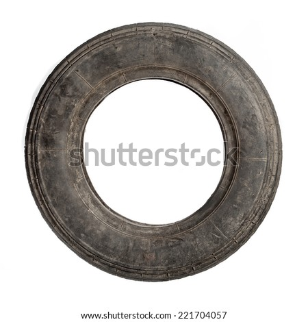 Small dirty old tire isolated over white - stock photo