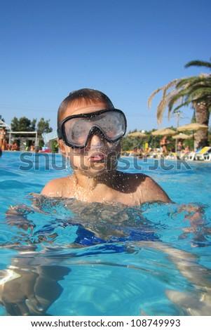 small diver boy near the beach - stock photo
