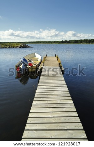 Small Dock and Boat, Gotland. - stock photo