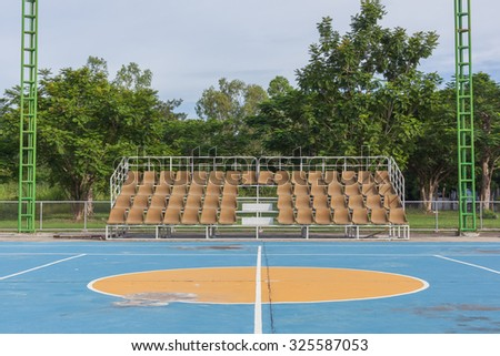 Small empty old brown grandstand with seating - stock photo