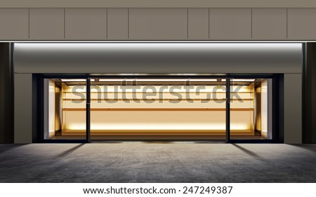 small empty shop on the city street at night - stock photo