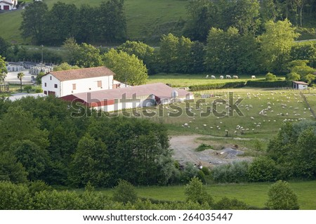 Small farm house and fields in Sare, France in Basque Country on Spanish-French border, a hilltop 17th century village in the Labourd province. - stock photo