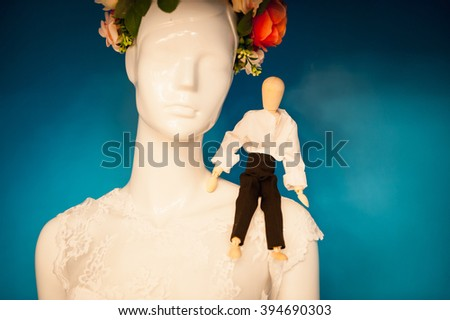 small figure man on the shoulder of the dummy in a wreath. - stock photo