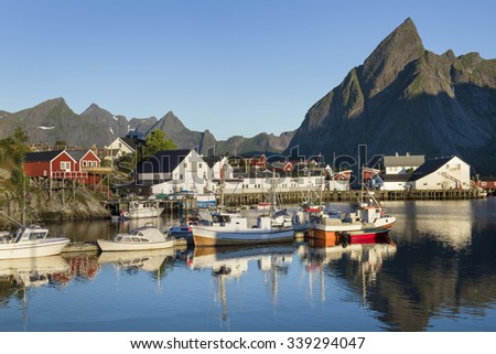 Small fishing port in the Hamnoy with Lilandstinden mountain peak on the background - Reine, Lofoten Islands, Norway - stock photo