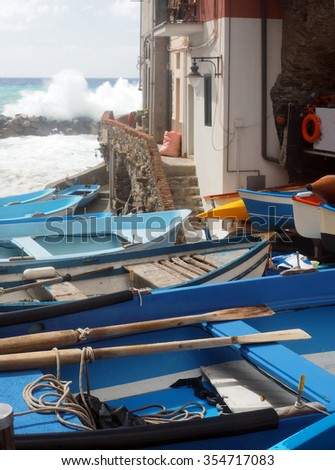 small fishing row boats on land during rough sea Rio Maggiore Cinque Terre Italy Europe     - stock photo