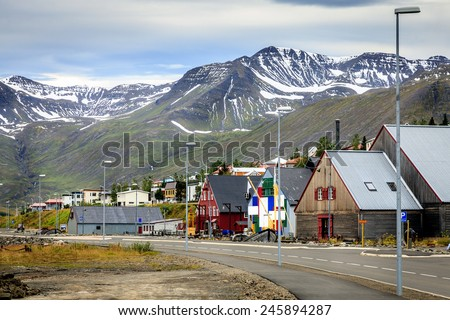 Small fishing town of Siglufjordur on the northern coast of Iceland - stock photo
