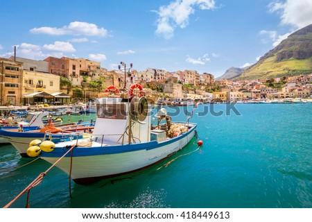 Small fishing village with boats at Sicily, Castellammare, Italy - stock photo
