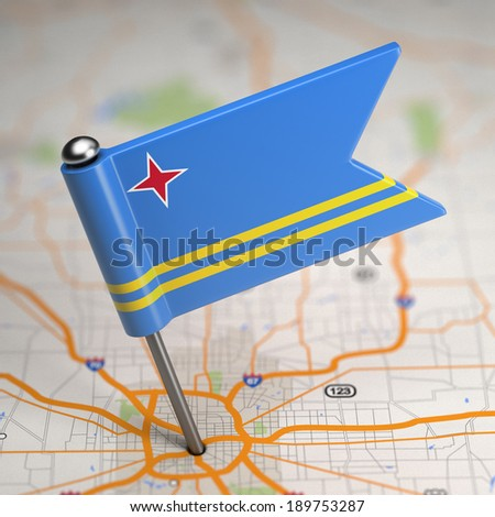 Small Flag of Aruba on a Map Background with Selective Focus. - stock photo