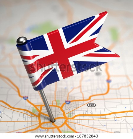 Small Flag of United Kingdom of Great Britain on a Map Background with Selective Focus. - stock photo