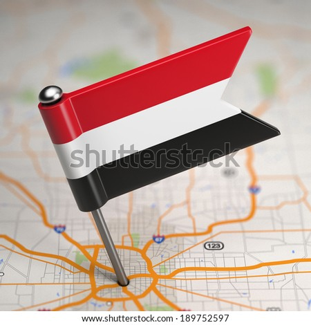 Small Flag of Yemen on a Map Background with Selective Focus. - stock photo