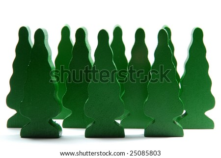Small forest made by wooden building blocks shaped like trees. - stock photo