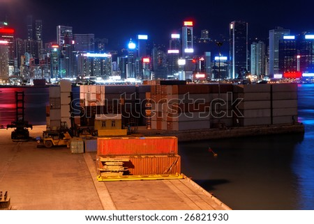 Small freight terminal in Hong Kong at night - stock photo
