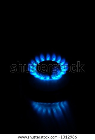 Small gas stove burning - look in profile for more - stock photo