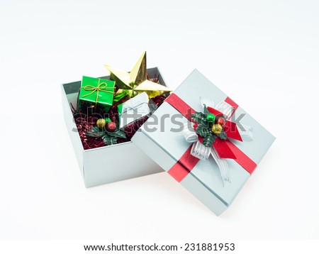 Small gift box in opened gift box - stock photo