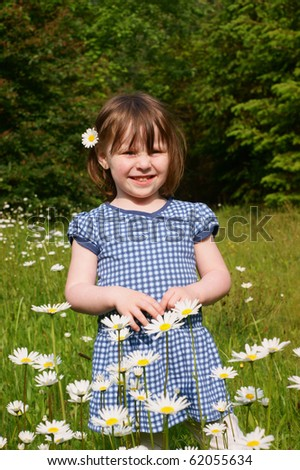 Small girl in the flowers - stock photo