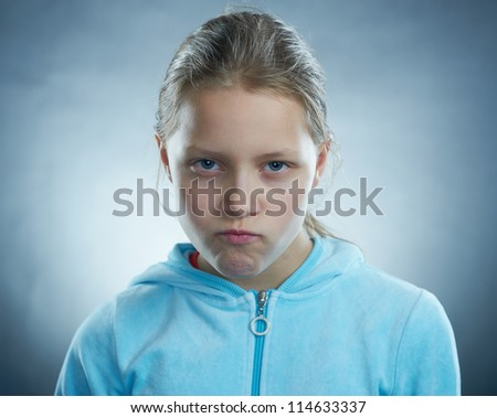 Small girl making funny faces - stock photo