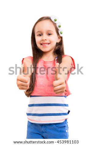 Small girl showing thumbs up, isolated over white background - stock photo